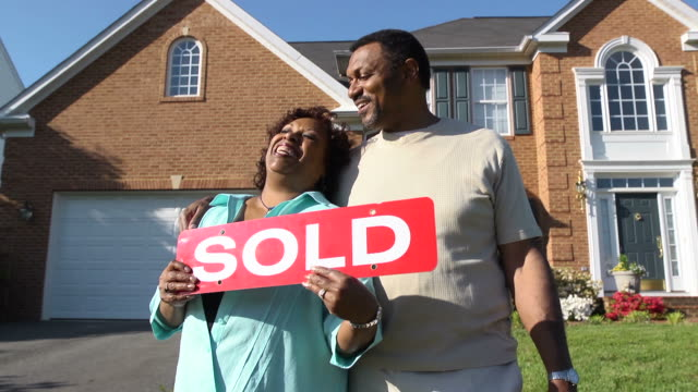 Happy Couple Holding SOLD Sign video