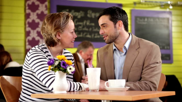 Happy couple in a cafe video