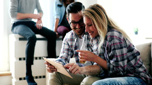 Happy couple in love surfing on tablet at home video