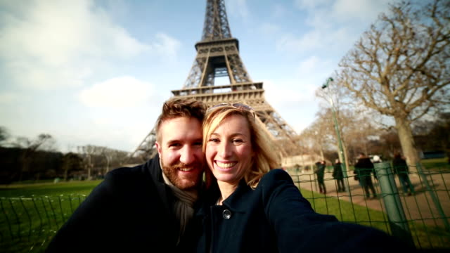 Happy couple in Paris taking selfie-Eiffel tower video