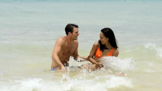 Happy couple in the sea video
