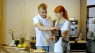 Happy couple making healthy organic juice in kitchen video