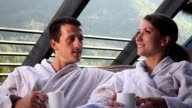 Happy couple of tourists in a spa video