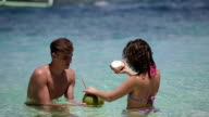 Happy couple on the beach with coconut video