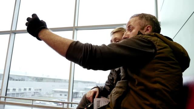 Happy couple or family taking selfie self-portrait video