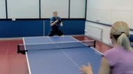 Happy couple playing the table tennis at the court video