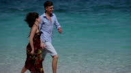 Happy Couple Running on Tropical Beach video