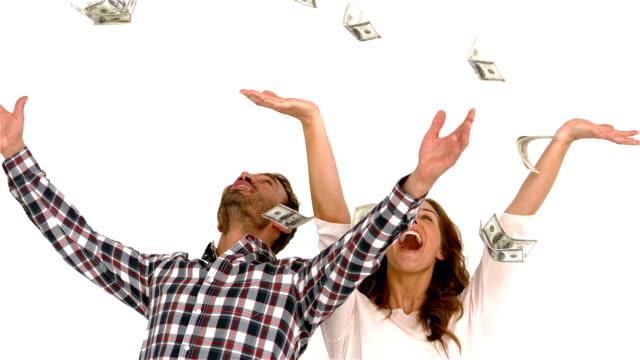 Happy couple throwing money video