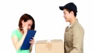 Happy delivery man delivering cardboard box video