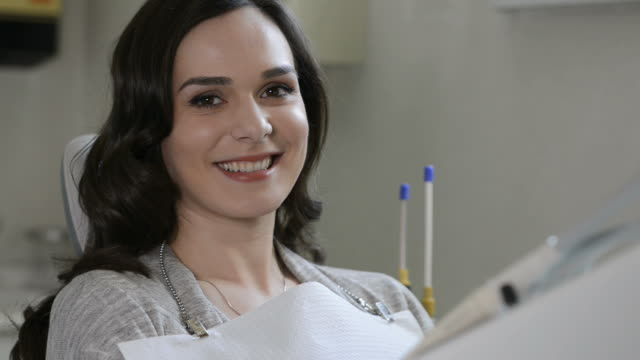 Happy dentist patient video