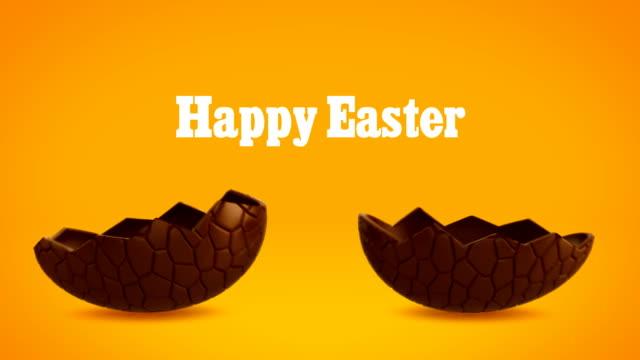 Happy Easter - Chocolate egg cracking, orange BG video