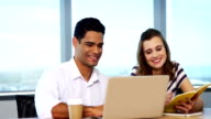 Happy executives using laptop video