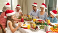 Happy extended family at the christmas dinner table video