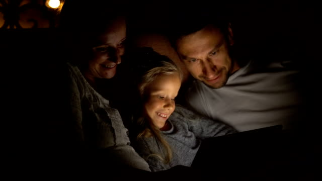 happy family at dusk looks hilarious film video