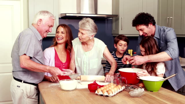 Happy family cooking biscuits together video
