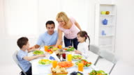 Happy family dining at the home. video