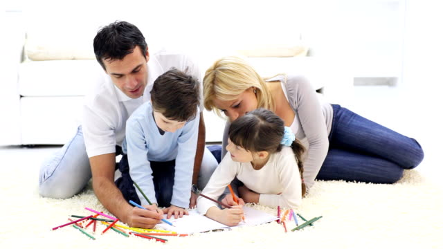 Happy family drawing in colorful pencils. video