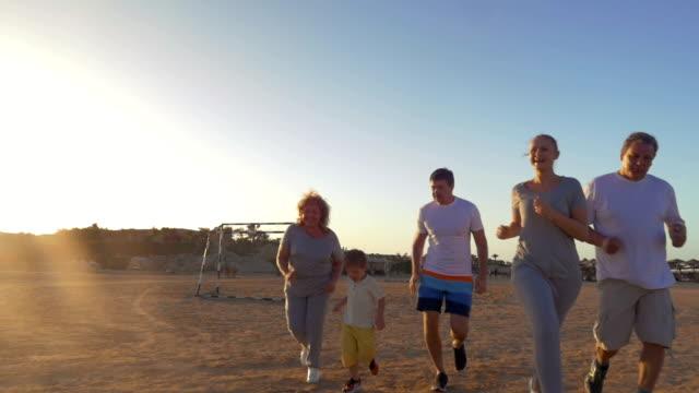 Happy family finishing evening jogging video