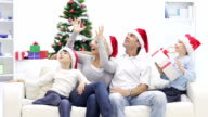 Happy family get Christmas gift. video