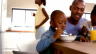 Happy family having breakfast together in the morning video