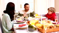 Happy family having christmas dinner together video