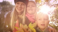 Happy family having fun in autumn park video