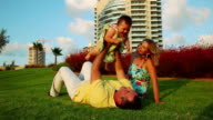 Happy Family in park. Father plays with his daughter video