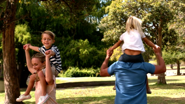 Happy family in the park together video