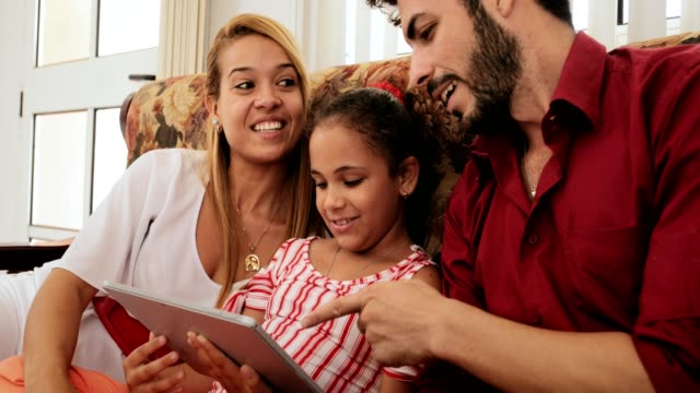 Happy Family Laughing Smiling Looking At Video On Ipad Tablet video