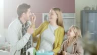 Happy family making a cake video