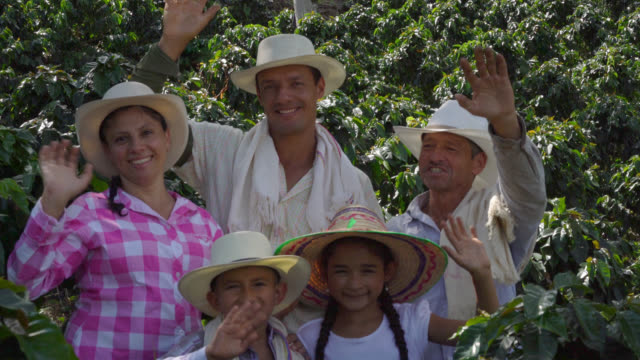 Happy family of farmers waving at the camera and smiling video