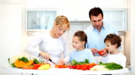 Happy family preparing a healthy dinner at home. video