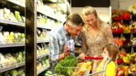 Happy family shopping vegetables video