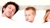 Happy family sleeping together video