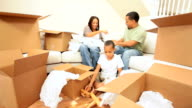 Happy Family Unpacking After House Move video