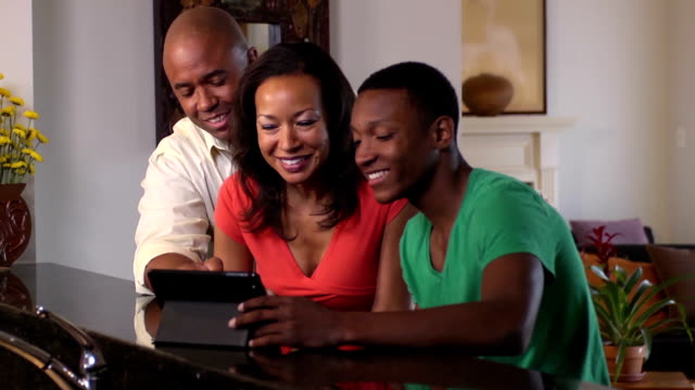 Happy Family Video Conferences Using Digital Tablet video