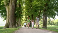 HD DOLLY: Happy Family Walking In The Park video