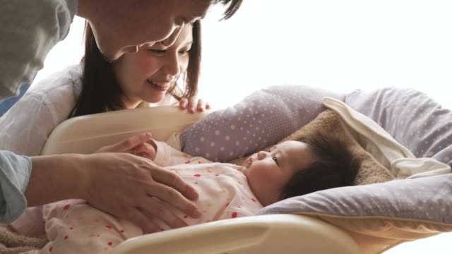 Happy family with newborn baby video