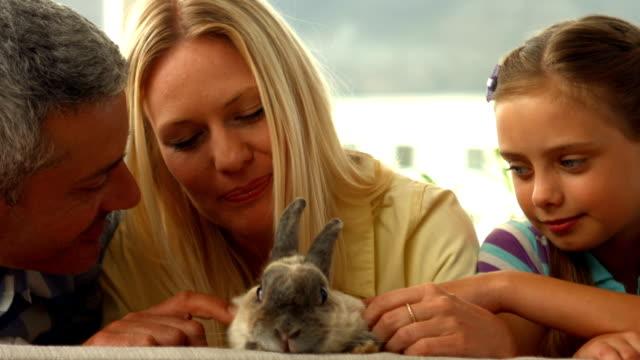 Happy family with pet rabbit video