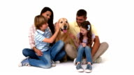 Happy family with their pet dog video