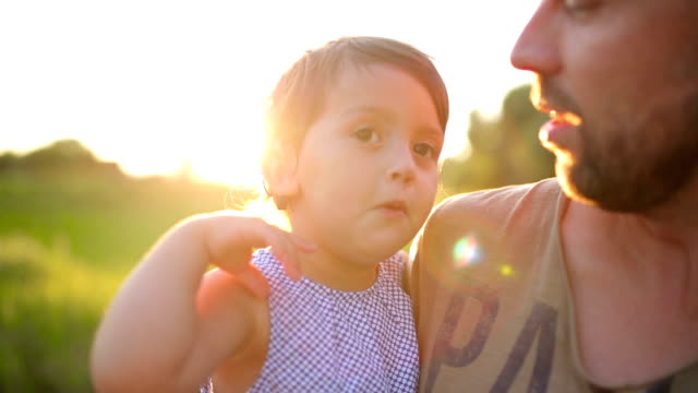 Happy Father and Little Daughter at sunset video