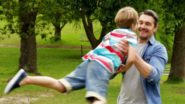Happy father and son playing in the park video