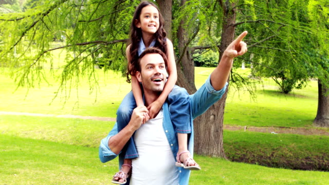 Happy father piggybacking daughter video