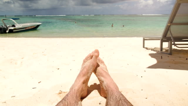 Happy feet at beach with boat in background video