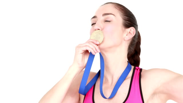 Happy female athlete holding medal video