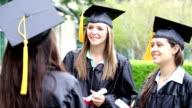 Happy female graduates talking on graduation day video