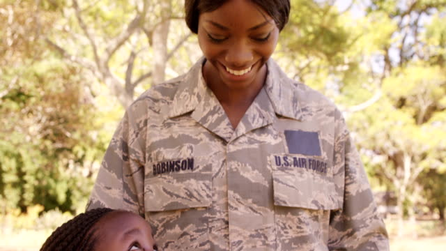Happy female military US AIR FORCE with her two children video