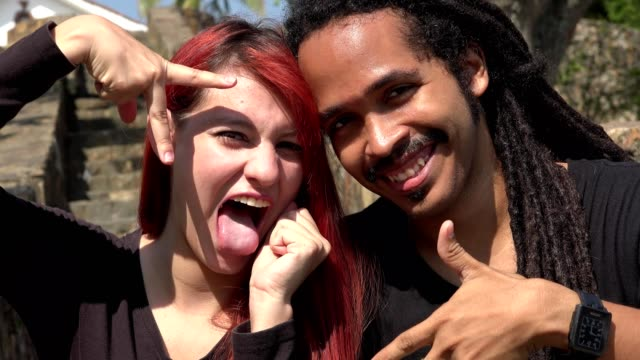 Happy Female Redhead Teen And African Man Posing video