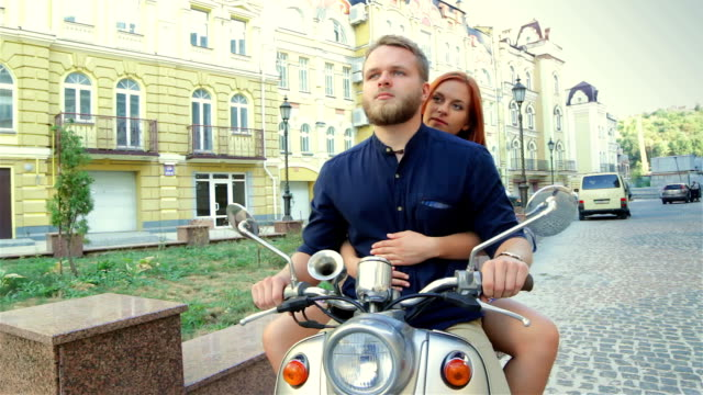 Happy freedom couple driving scooter video