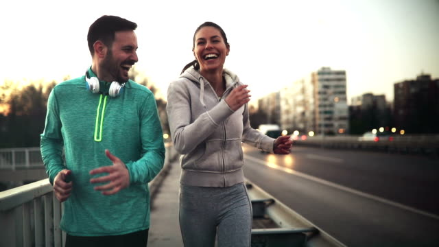Happy friends and sports people jogging and running outdoor video
